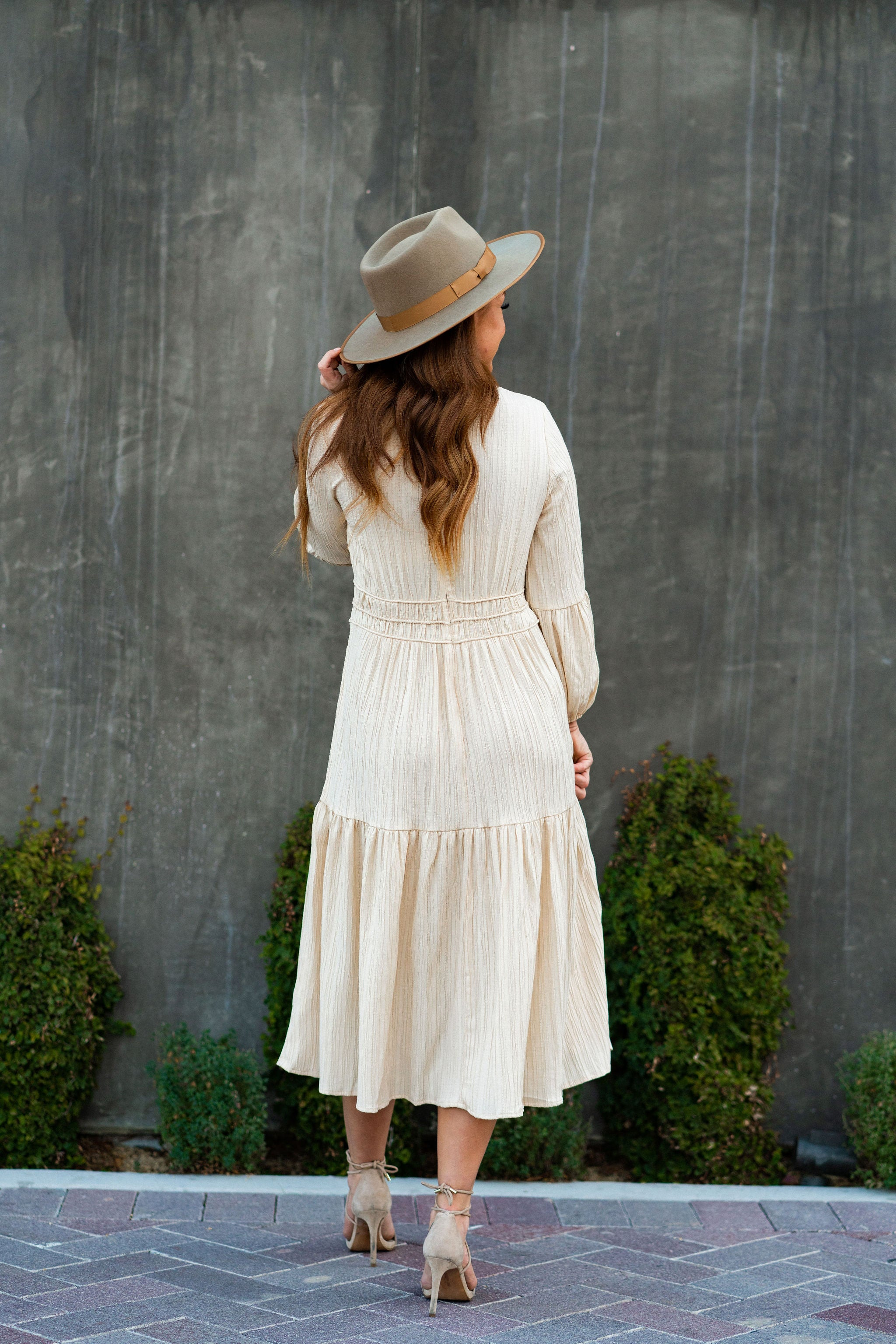 THE PRESLEE PLEATED MIDI DRESS IN CREAM