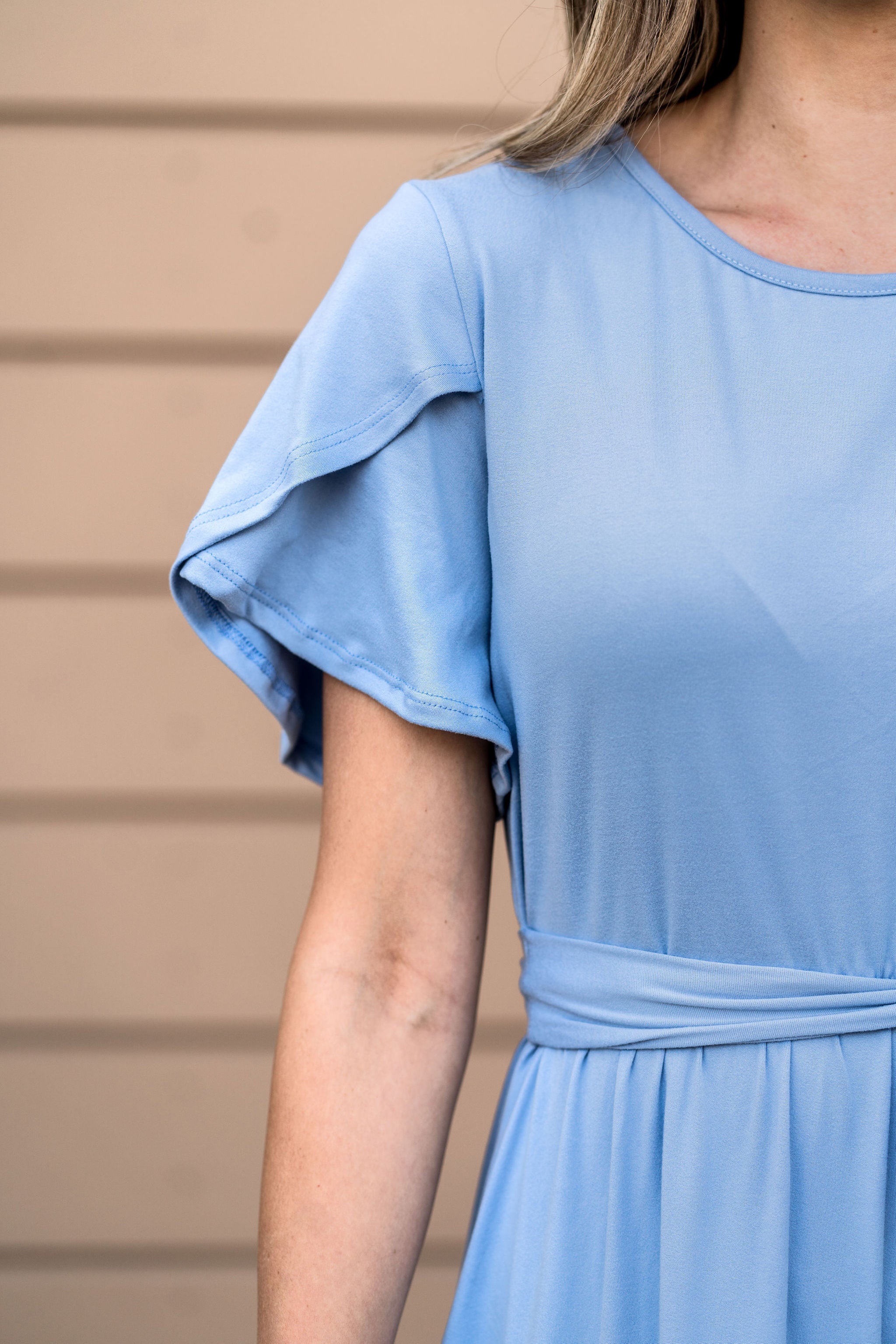THE EMERY FLUTTER SLEEVE DRESS IN SKY BLUE