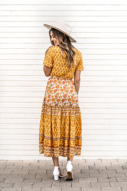 THE MARIA PATTERNED MAXI DRESS IN BUTTERSCOTCH