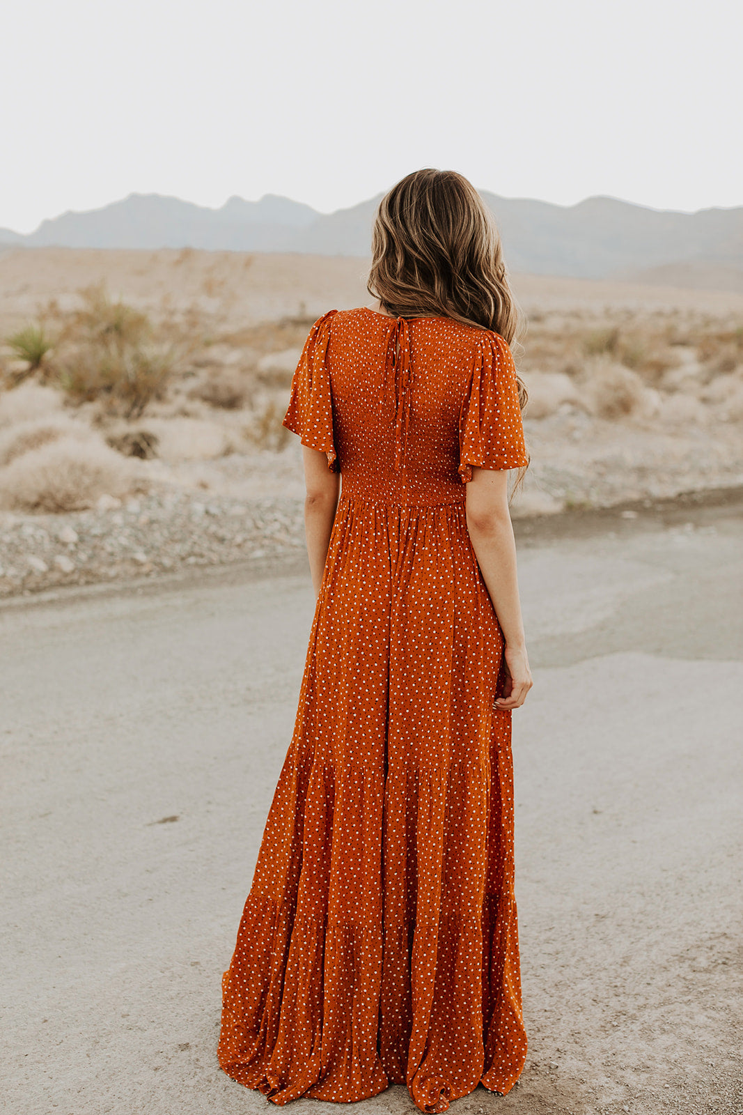 THE ESTELLE SMOCKED MAXI DRESS IN RUST