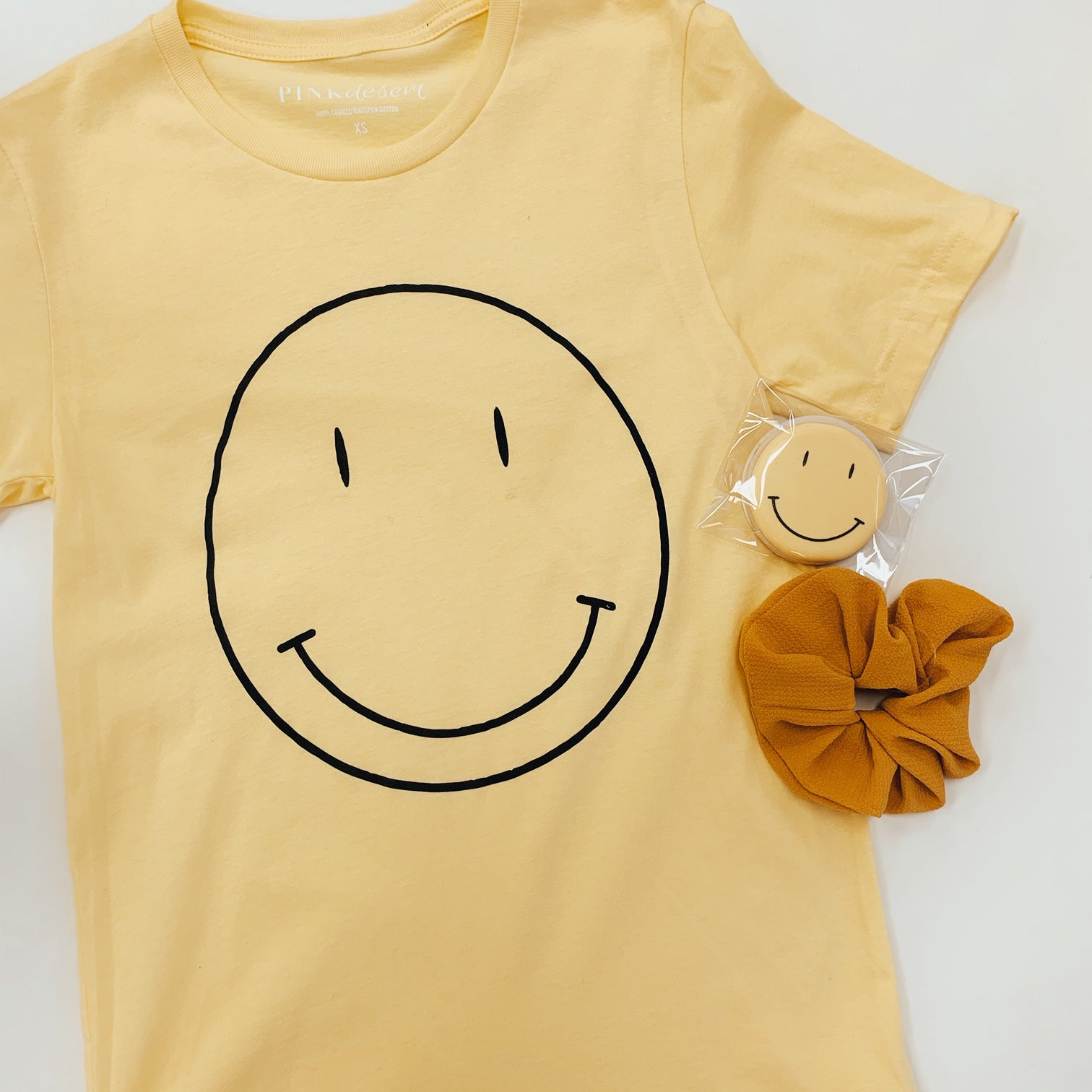 THE SMILEY FACE GRAPHIC TEE BY PINK DESERT