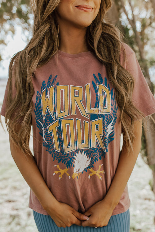 THE WORLD TOUR GRAPHIC TEE IN BRICK