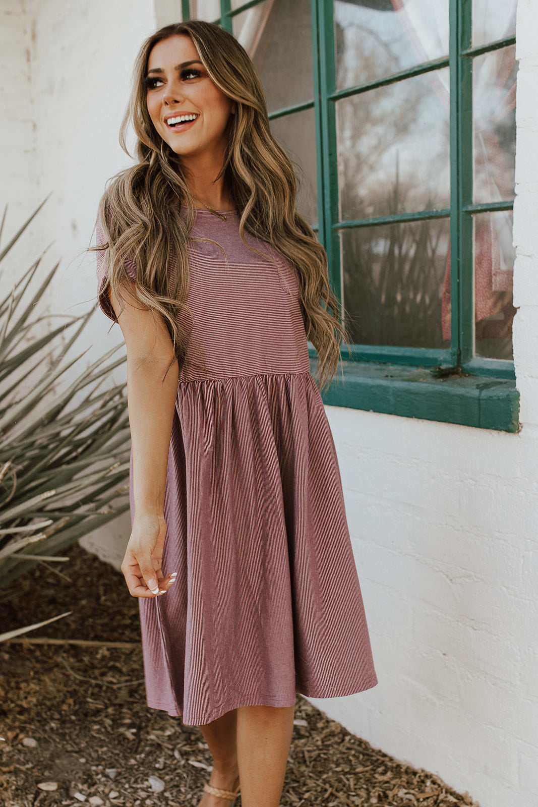 THE BODHI STRIPED BABYDOLL DRESS IN MAUVE