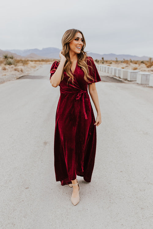 THE ROSLYN VELVET WRAP DRESS IN MERLOT