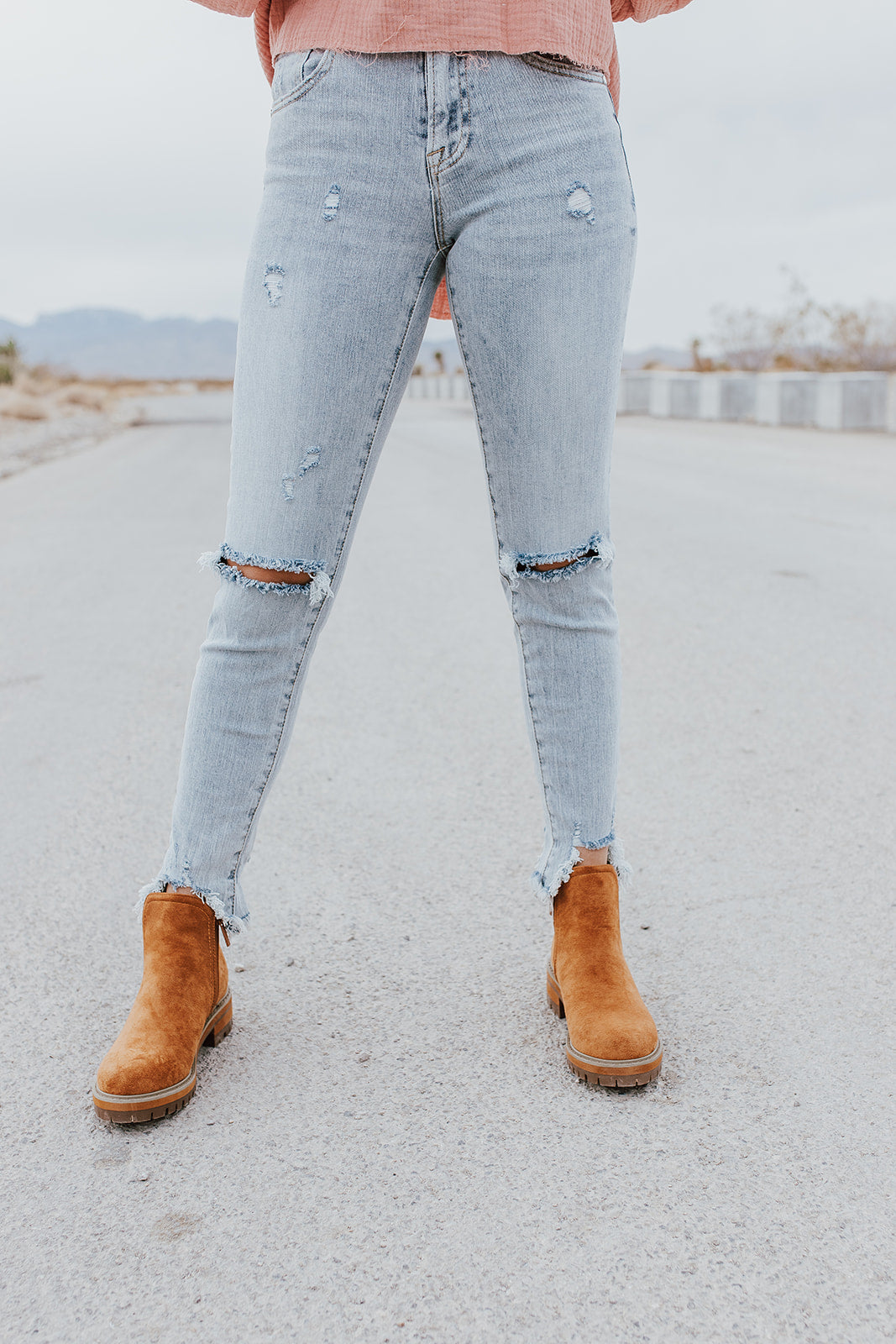 THE MELINDA MID RISE SLIM JEANS IN LIGHT WASH