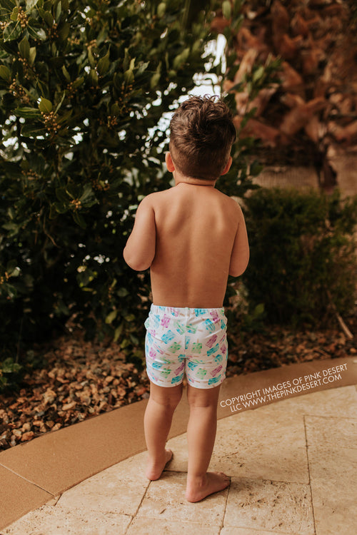 PINK DESERT BOYS EUROPEAN CUT SWIM SHORT IN POPSICLE