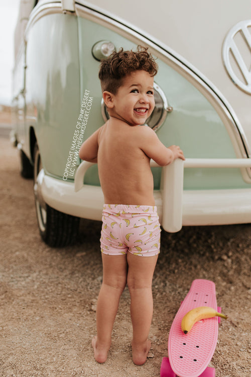 PINK DESERT BOYS EUROPEAN CUT SWIM SHORT IN BUBBLEGUM BANANA