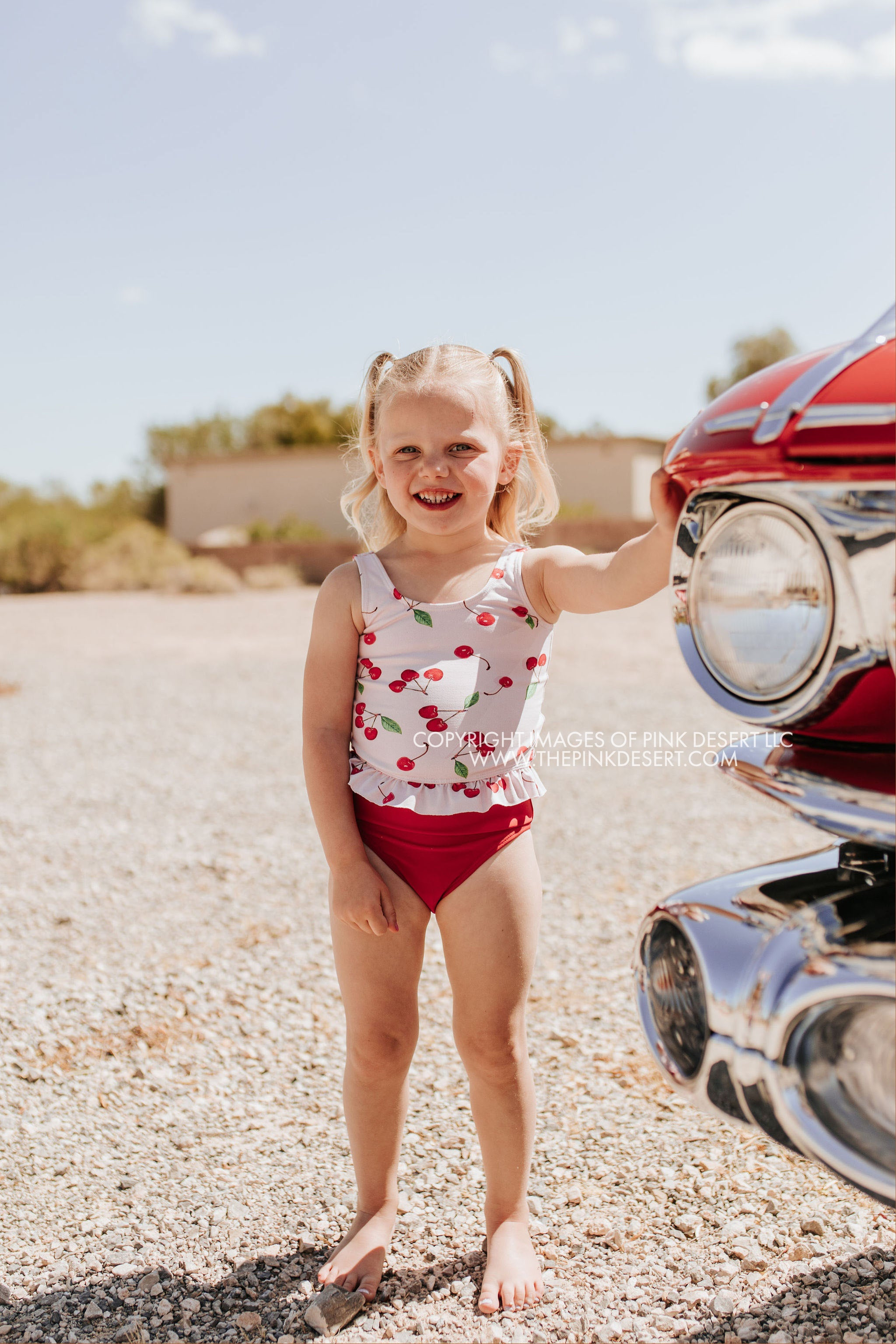 PINK DESERT GIRLS MINI RUFFLE PEPLUM SWIMSUIT SET IN CHERRY BOMB AND CHERRY RED