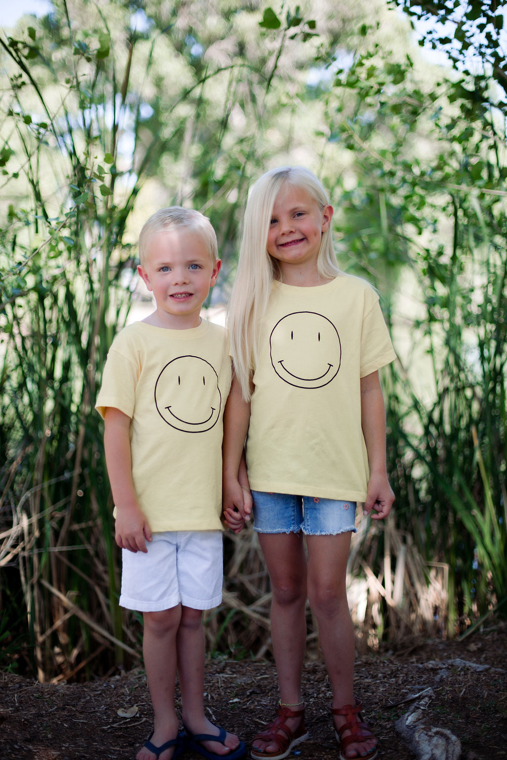 THE KID SMILEY FACE GRAPHIC TEE IN YELLOW