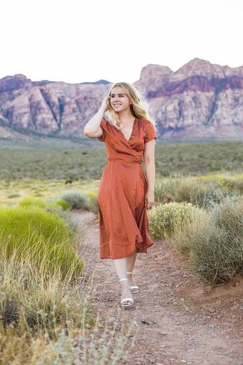 THE WENDY WRAP POLKA DOT MIDI DRESS IN RUST