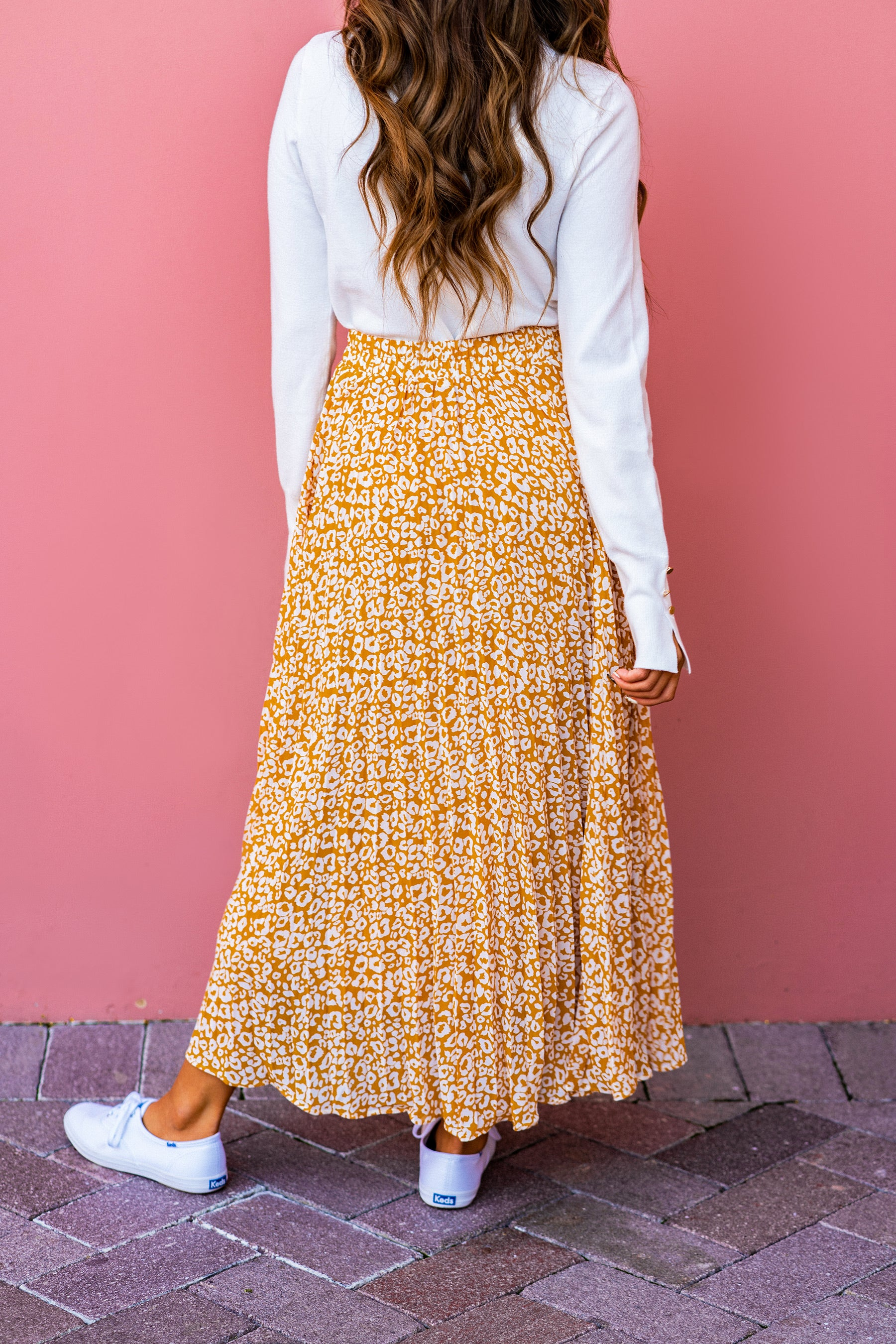 THE LILA LEOPARD PLEATED MIDI SKIRT IN MARIGOLD