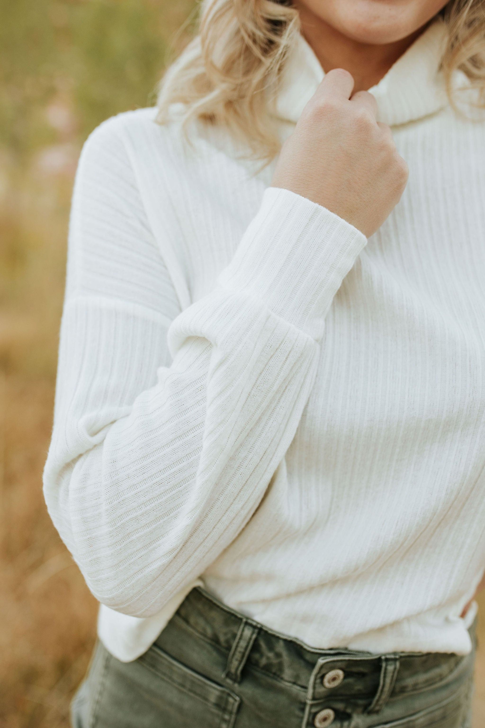 THE TESSA TURTLENECK SWEATER IN IVORY