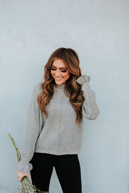 THE GLENDORA RUFFLE SWEATER IN GREY