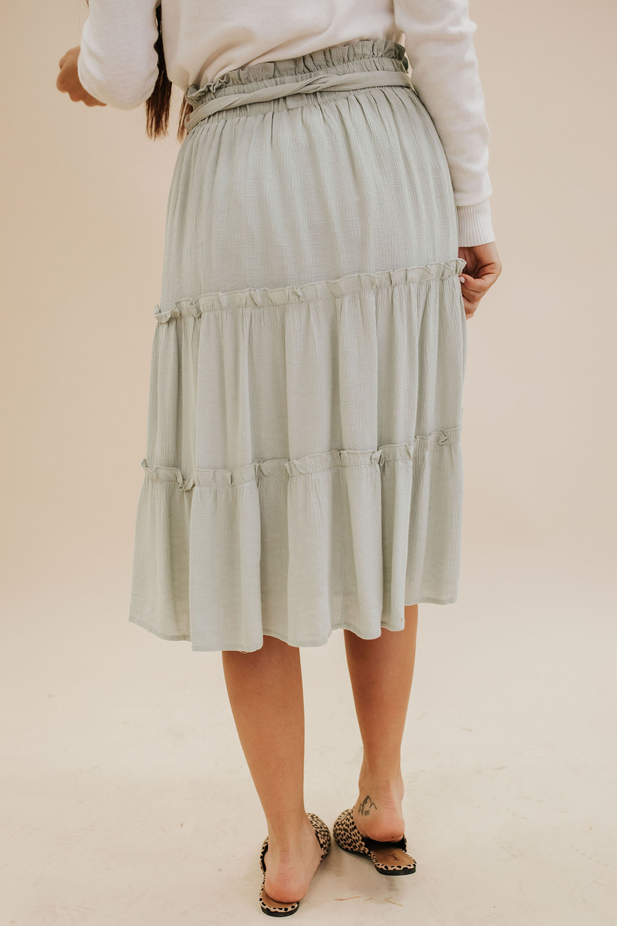 THE AFTERGLOW RUFFLE SKIRT IN LIGHT SAGE