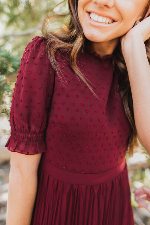 THE COSETTE SWISS DOT DRESS IN HOLLY BERRY BY PINK DESERT