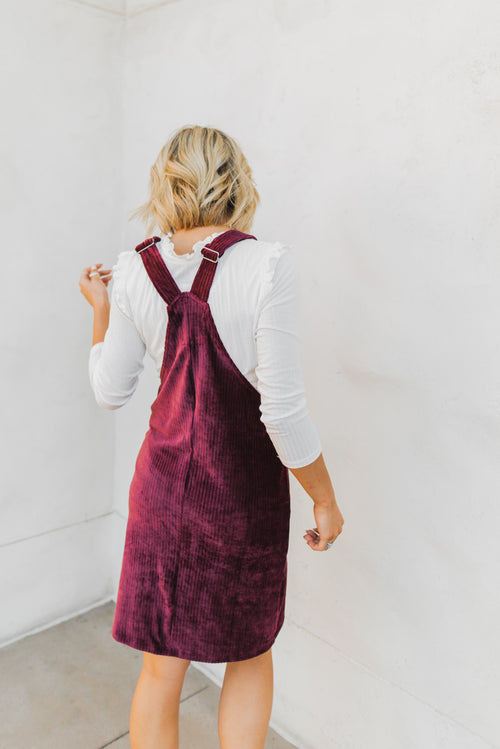 THE GABBY CORDUROY OVERALL DRESS IN BURGUNDY