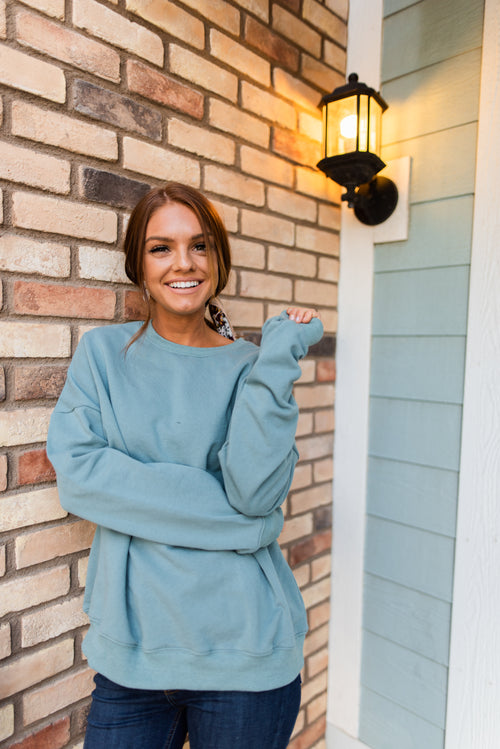 THE BUNDLED UP SWEATSHIRT IN TEAL