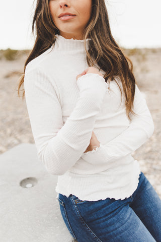 THE EMMA POM SWEATER IN CREAM