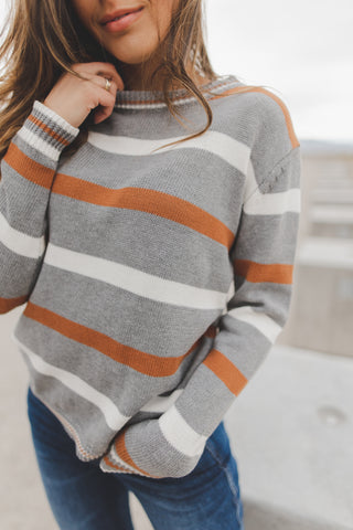 THE REGINA RUFFLE SWEATER IN GREY STRIPE