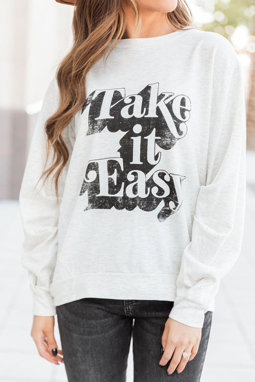 THE TAKE IT EASY GRAPHIC SWEATER IN HEATHER GREY