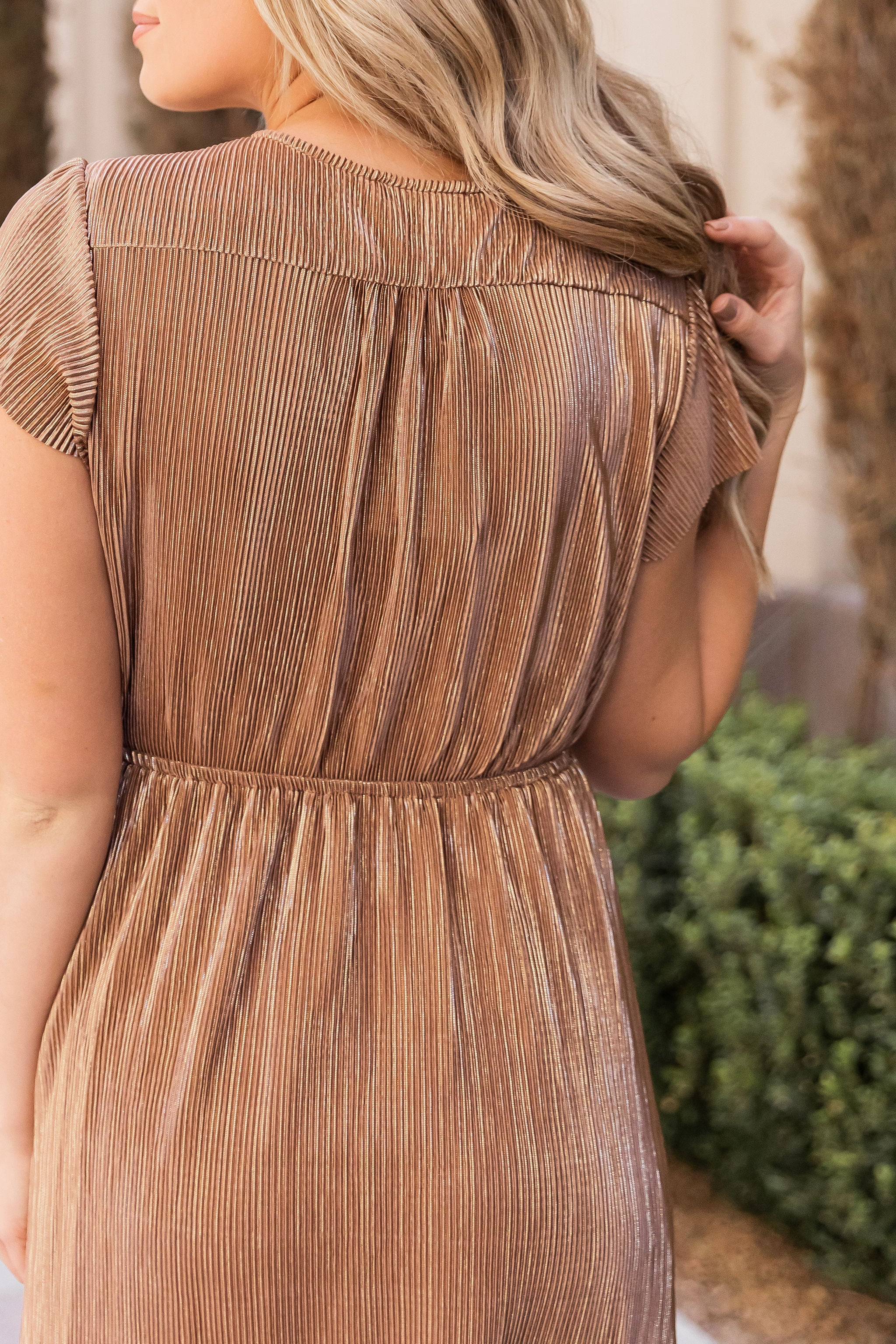 THE MARIAH METALLIC PLEATED DRESS IN BRONZE