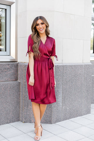 THE PAIGE PLEATED MIDI DRESS IN WINE