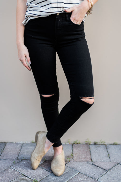 THE SKINNY KNEE-SLIT JEANS IN BLACK