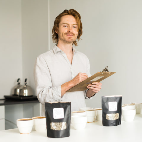 Cole Torode smiling in his cupping lab