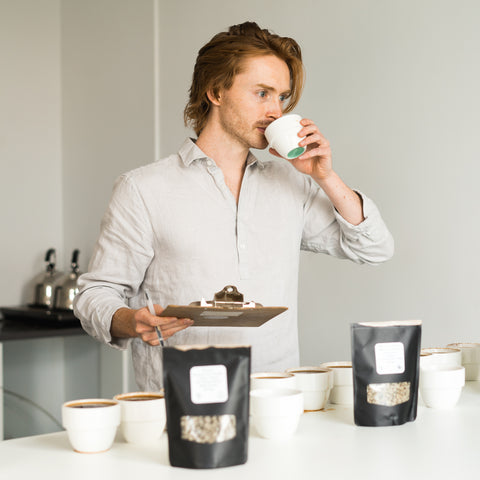 Cole Torode sipping cupping coffees