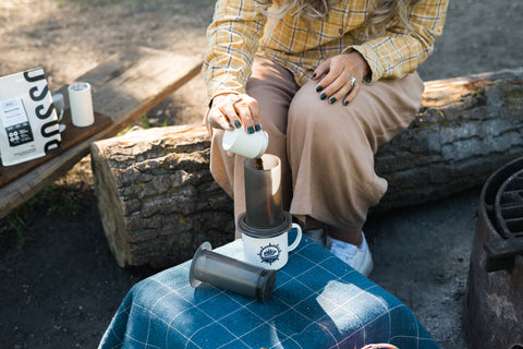 Pouring grinds in Aeropress while camping
