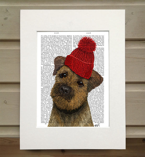 Border Terrier with Red Bobble Hat Book Print