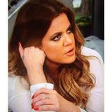 "<a href=""http://rockmintstyle.com/products/alex-mika-stacked-x-ring-gold/"" target=""_blank"" >Khloe Kardashian wearing Alex Mika Stacked X Ring Gold</a>"