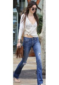 "<a href=""http://rockmintstyle.com/products/j-j-winters-taupe-mini-suede-fringe-bag/"" target=""_blank"" >Kylie Jenner wearing J.J. Winters Mini Fringe Bag</a>"