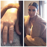 "<a href=""http://rockmintstyle.com/products/alex-mika-stacked-x-ring-gold/"" target=""_blank"" >Kim Kardashian wearing Alex Mika Stacked X Ring Gold</a>"