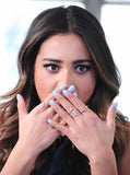 "<a href=""http://rockmintstyle.com/products/alex-mika-criss-cross-ring-gold/"" target=""_blank"" > Shay Mitchell wearing Alex Mika Criss Cross Ring as a circle</a>"