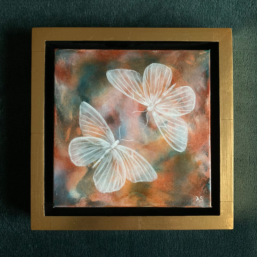 Ethereal moths colorful original painting by Aimee Schreiber in a gold floater frame