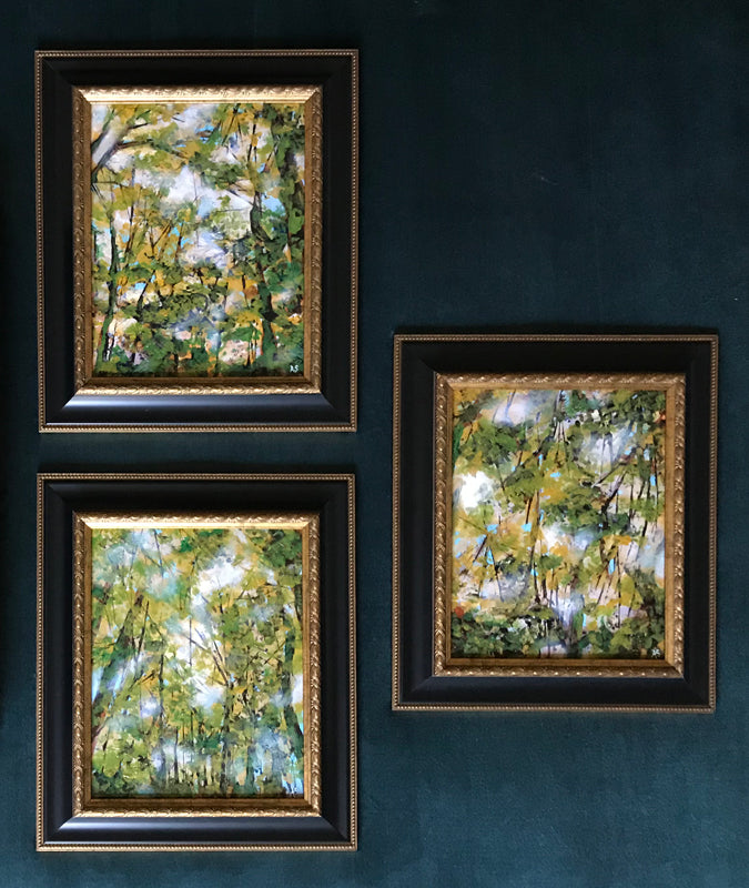 3 framed Fall forest nature paintings on teal gallery wall by Aimee Schreiber
