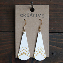 Load image into Gallery viewer, Lightweight dangle earrings made from recycled chipboard, hand painted in white and gold, and made with gold ear wire.