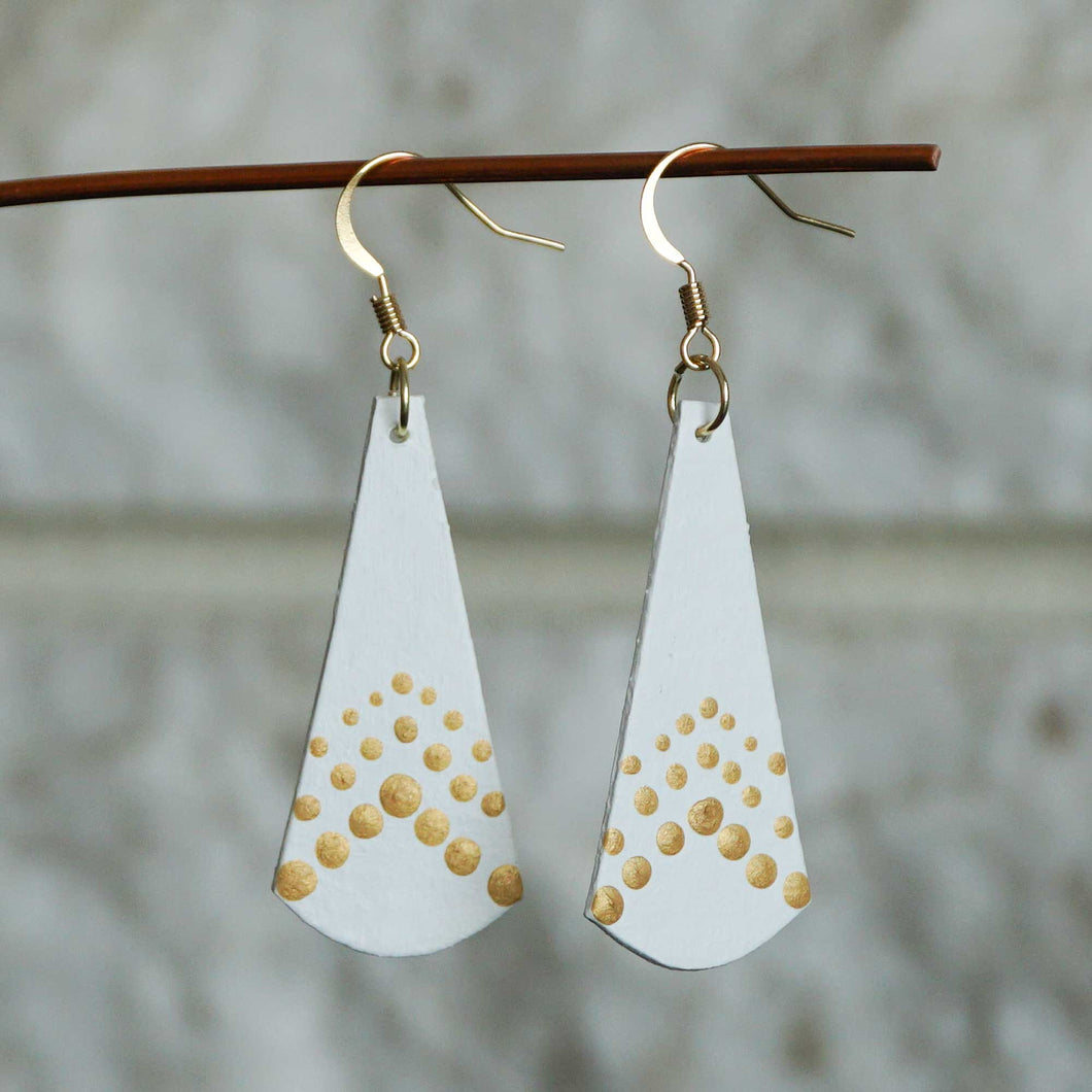 Lightweight dangle earrings made from recycled chipboard, hand painted in white and gold, and made with gold ear wire.