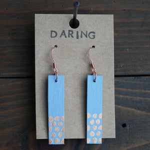 Rectangle dangle earrings made from recycled chipboard, hand painted in periwinkle blue and copper, and made with copper ear wire.
