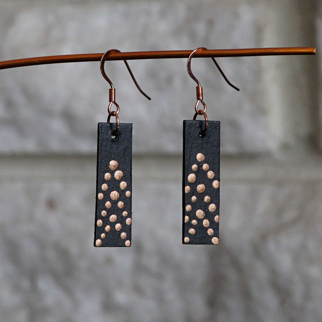 Rectangle dangle earrings made from recycled chipboard, hand painted in black and copper, and made with copper ear wire.