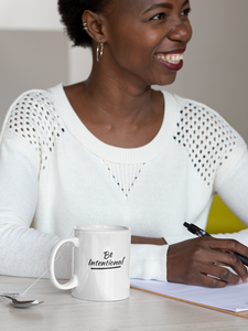 African American woman with Be Intentional Mug by CP Designs Unlimited