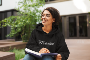 African American woman wearing Motivated  hoodie by CP Designs Unlimited