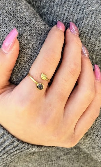 adjustable small brass ring with a stone.