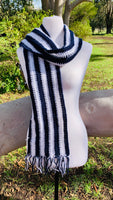 Dark blue and white vertical stripe scarf.