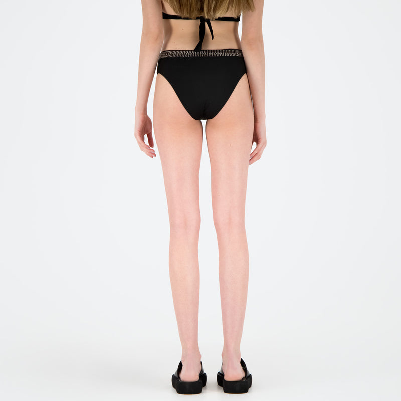 Swimsuit with heat-sealed studs