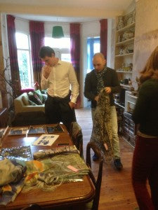 Max and Ryan looking through photographs and our SS14 scarves
