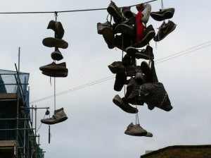 Shoes hanging above the street