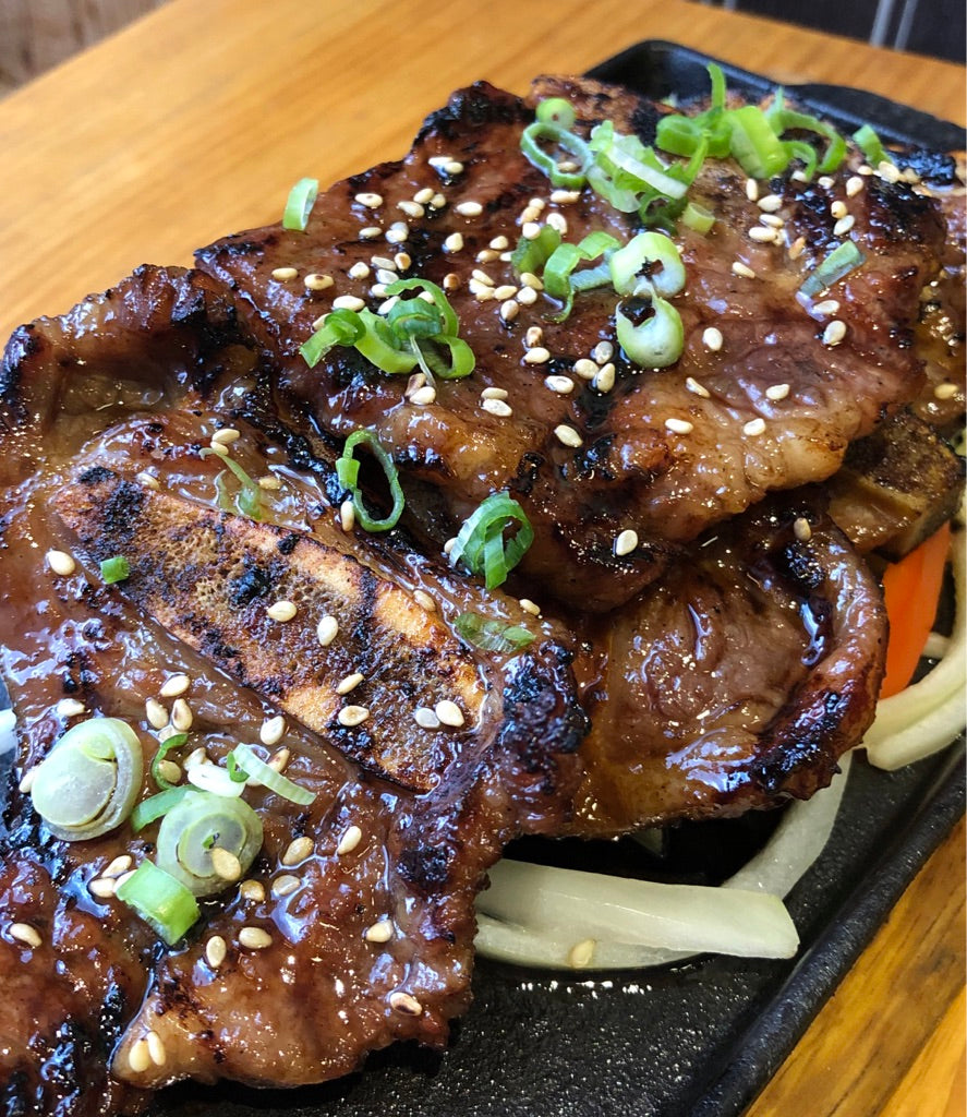 A delicious and traditional korean BBQ staple - LA style kalbi beef shortribs, marinated in a soy-based sweet and salty marinade, then grilled to perfection.