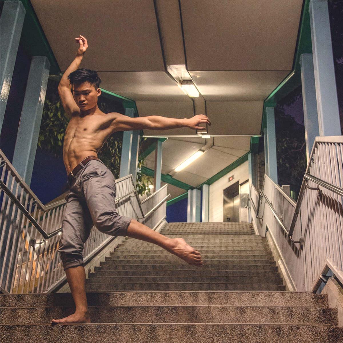 Rhyn Cheung is seen dancing barefoot on an outdoor staircase
